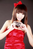 Young girl with camera Stock Photography