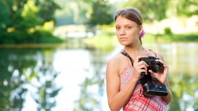 Young girl with camera Royalty Free Stock Photography