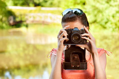 Young girl with camera Stock Image