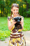 Young girl with camera Stock Photos