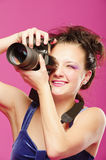 Young girl with camera Royalty Free Stock Image