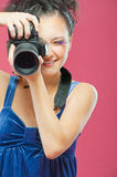 Young girl with camera Stock Images