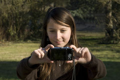 Young girl with a camera Stock Images