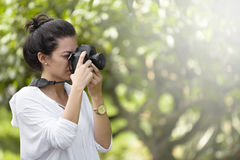 Young girl with camera Royalty Free Stock Images