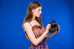 Young girl with camera in hand Royalty Free Stock Images