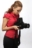 Young girl with a camera over white background Royalty Free Stock Image