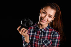 Young girl with a camera Royalty Free Stock Photos