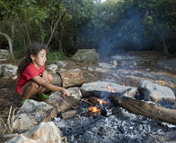 Young girl campfire stock image