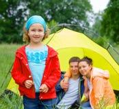 Young girl camping Royalty Free Stock Photos