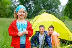 Young girl camping Stock Photo