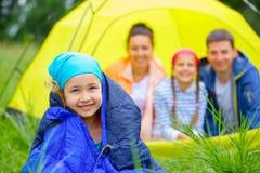 Young girl camping Stock Photos