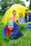 Young girl camping Stock Image