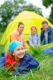 Young girl camping Stock Photography
