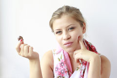 Young girl with a candy in her hand stock photo