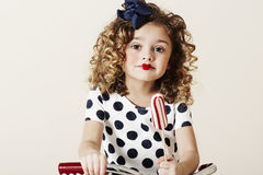 Young girl with candy Royalty Free Stock Photography