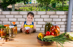 Young Girl Canning Preserves of Fresh Vegetables Royalty Free Stock Photo