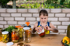 Young Girl Canning Preserves of Fresh Vegetables Stock Image