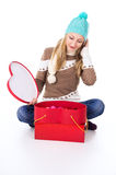 Young girl in a cap with gifts wonders Stock Photo