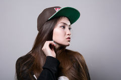 Young girl in a cap. Royalty Free Stock Photo