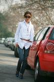 Young girl with car Stock Photos