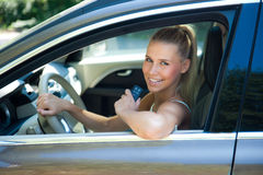 Young girl in car with car key Stock Photos