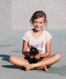Young girl caress with kitten. Girl craddle kitten in arms Stock Photo