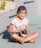 Young girl caress with kitten. Girl craddle kitten in arms Royalty Free Stock Photography