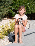 Young girl caress with kitten Stock Photo