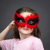 Young girl in carnival mask Stock Photography