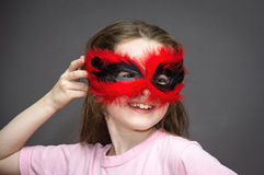 Young girl in carnival mask Stock Images