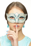 Young girl in a carnival mask Stock Photos