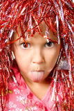 Young girl with carnival wig Stock Image