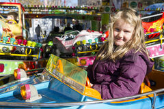 Young girl on carousel Stock Images