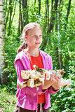 Young girl carries firewood from forest Royalty Free Stock Image