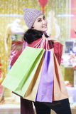 Young girl carries shopping bags at mall Royalty Free Stock Photos