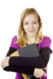 Young girl carry books Stock Image