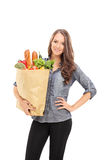 Young girl carrying a bag full of groceries Royalty Free Stock Photos