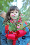 Young girl carrying flowers Stock Image
