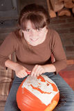 Young girl carving a pumpking Stock Image