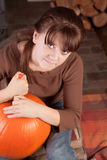 Young girl carving a pumpking Royalty Free Stock Photography