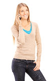 Young girl in casual clothes talking on a cell phone Royalty Free Stock Photo