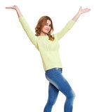 Young girl casual dressed jeans and a green sweater posing open arms in studio on white background stock image