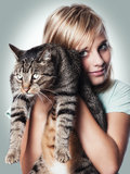 Young girl with cat. A young girl snuggles with best friend cat Stock Photography