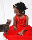 Young Girl and cat. 6 year old Leila. Loves to model. Posing with her cat Royalty Free Stock Photos