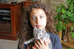 Young girl with cat. Young girl holding a cat in her arms Stock Photography
