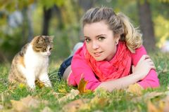 Young girl with cat on natural background Royalty Free Stock Image
