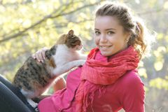 Young girl with cat outdoors Stock Images