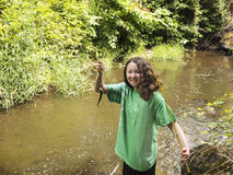 Young Girl Catches Small Trout Stock Photography