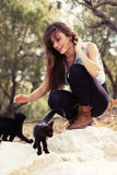 Young girl with cats outdoots Royalty Free Stock Photography