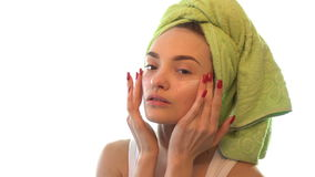 A young girl causing cream on her face stock footage